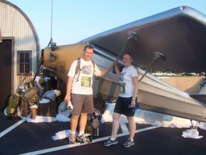 Jess and Matt in front of a plane
