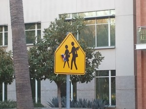 Pedestrian Crossing Sign with Red Bull Wings
